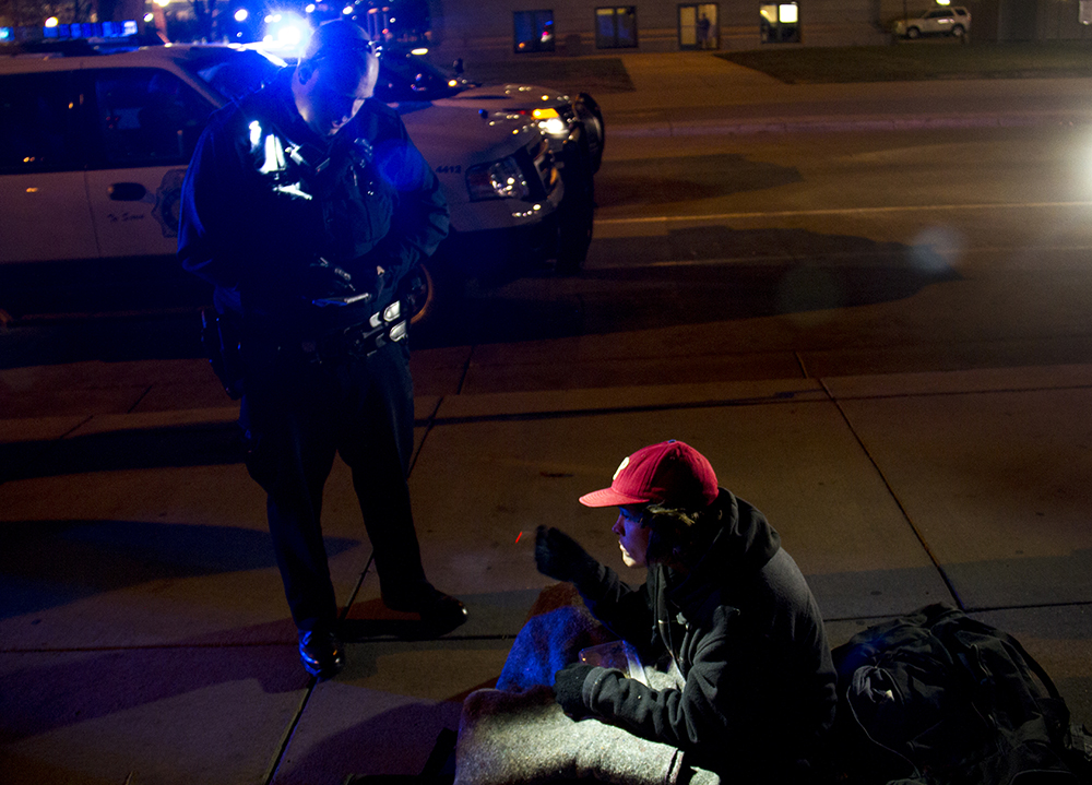 Protesters who have set up camp in front of the City and County Building to denounce Denver's urban camping ban are removed by police. Nov. 29, 2016. (Kevin J. Beaty/Denverite)  camping ban; right to rest; homeless sweeps; city and county building; police; protest; kevinjbeaty; denver; denverite; colorado;