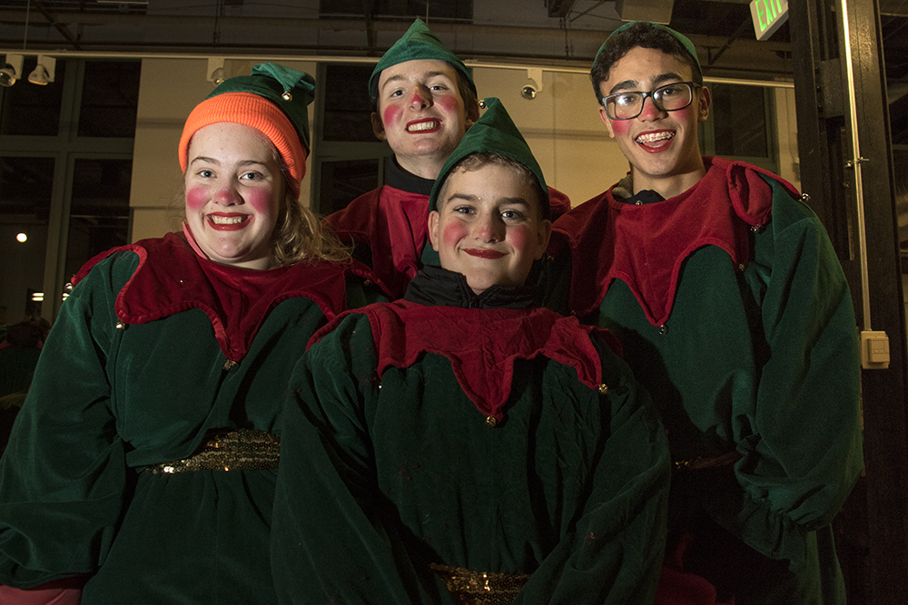 Overland High School students Maggie O'Riley (right to left), Grant Gulevich, Finn O'Riley and Malik Elgomati before the parade of lights. Dec. 2, 2016. (Kevin J. Beaty/Denverite)  parade of lights; holiday; christmas; civic center; kevinjbeaty; denver; denverite; colorado;