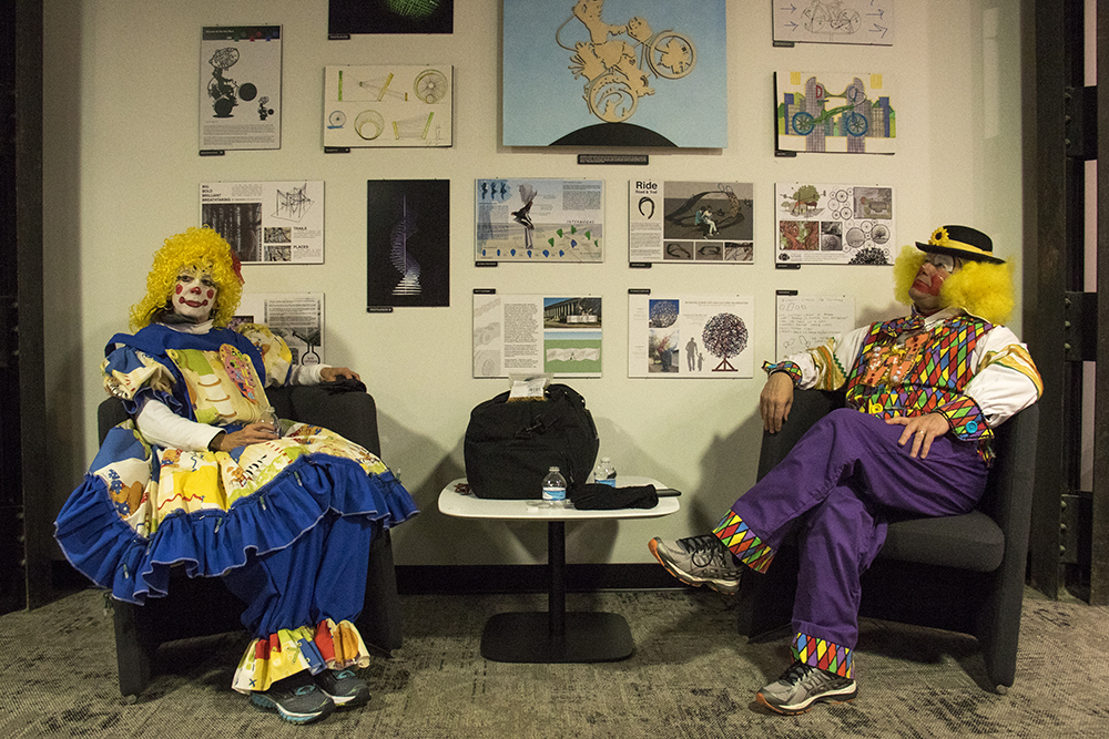 Clowns Tracey Campbell and Mark Williams in the clown dressing room before the parade of lights. Dec. 2, 2016. (Kevin J. Beaty/Denverite)  parade of lights; holiday; christmas; civic center; kevinjbeaty; denver; denverite; colorado;