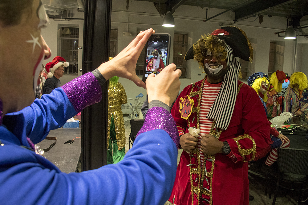 Clown Terrance Carroll in the clown dressing room before the parade of lights. Dec. 2, 2016. (Kevin J. Beaty/Denverite)parade of lights; holiday; christmas; civic center; kevinjbeaty; denver; denverite; colorado;