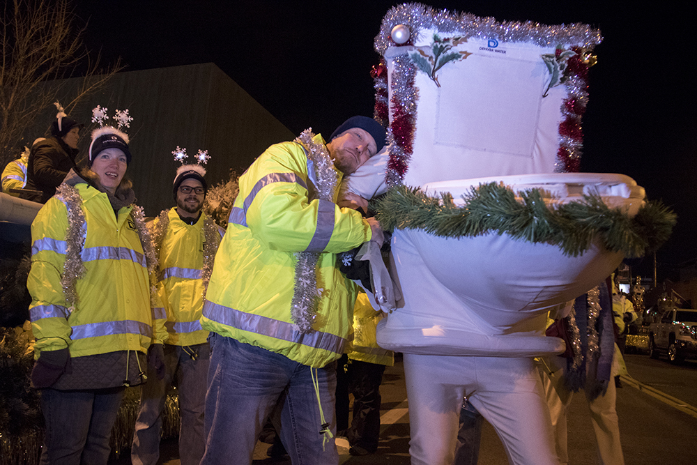 Steve Snyder and the Denver Water Running Toilet at the parade of lights. Dec. 2, 2016. (Kevin J. Beaty/Denverite)parade of lights; holiday; christmas; civic center; kevinjbeaty; denver; denverite; colorado;