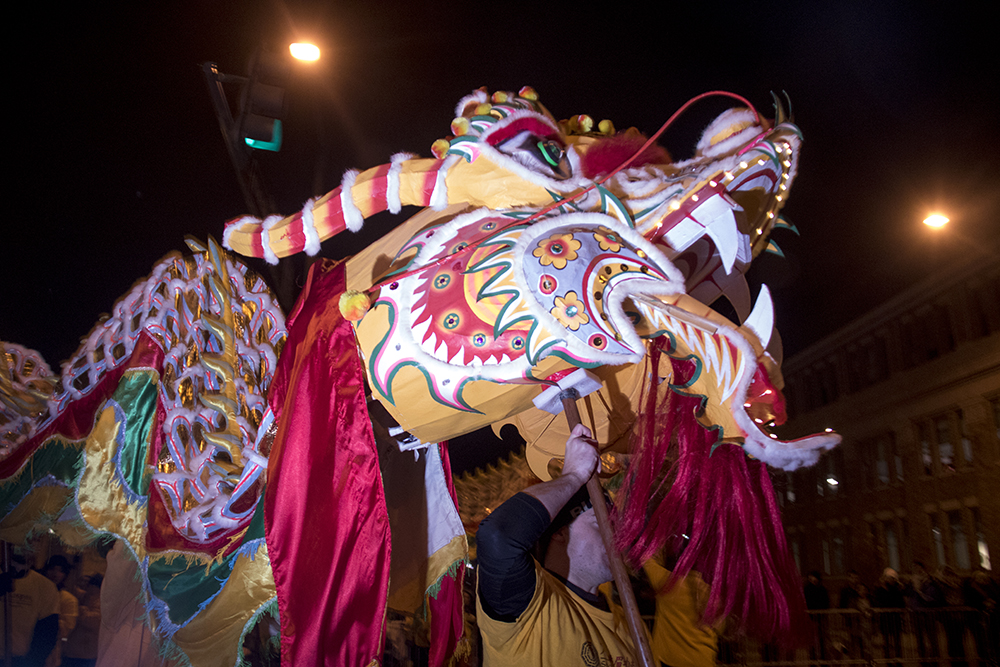 A dragon operated by the  Shaolin Hung Mei Kung Fu school. Parade of lights. Dec. 2, 2016. (Kevin J. Beaty/Denverite)  parade of lights; holiday; christmas; civic center; kevinjbeaty; denver; denverite; colorado;