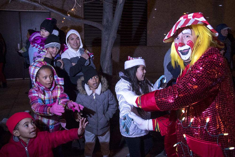 Clowns delight children. Parade of lights. Dec. 2, 2016. (Kevin J. Beaty/Denverite)  parade of lights; holiday; christmas; civic center; kevinjbeaty; denver; denverite; colorado;