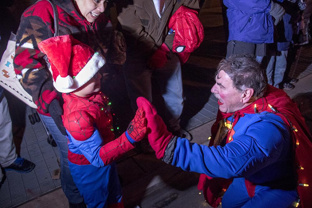 Superman high-fives spiderman. Parade of lights. Dec. 2, 2016. (Kevin J. Beaty/Denverite)parade of lights; holiday; christmas; civic center; kevinjbeaty; denver; denverite; colorado;