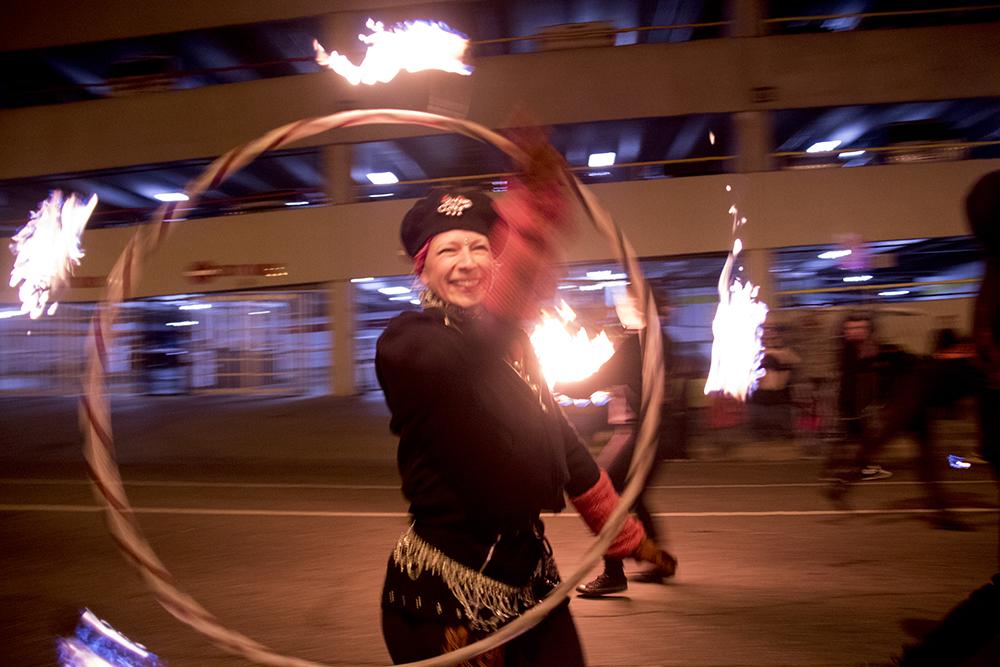 Firedancers march down Tremont. Parade of lights. Dec. 2, 2016. (Kevin J. Beaty/Denverite)  parade of lights; holiday; christmas; civic center; kevinjbeaty; denver; denverite; colorado;
