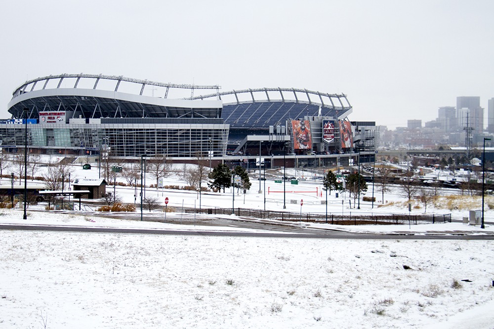 Sports Authority Field on a snowy day. (Kevin J. Beaty/Denverite)  sports authority field; broncos; football; cowx; weather; cold; snow; winter; kevinjbeaty; denver; colorado; denverite;
