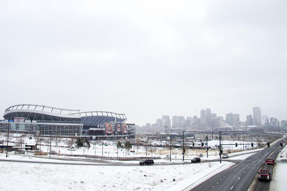 Sports Authority Field on a snowy day. (Kevin J. Beaty/Denverite)  sports authority field; broncos; football; skyline; cityscape; cowx; weather; cold; snow; winter; kevinjbeaty; denver; colorado; denverite;