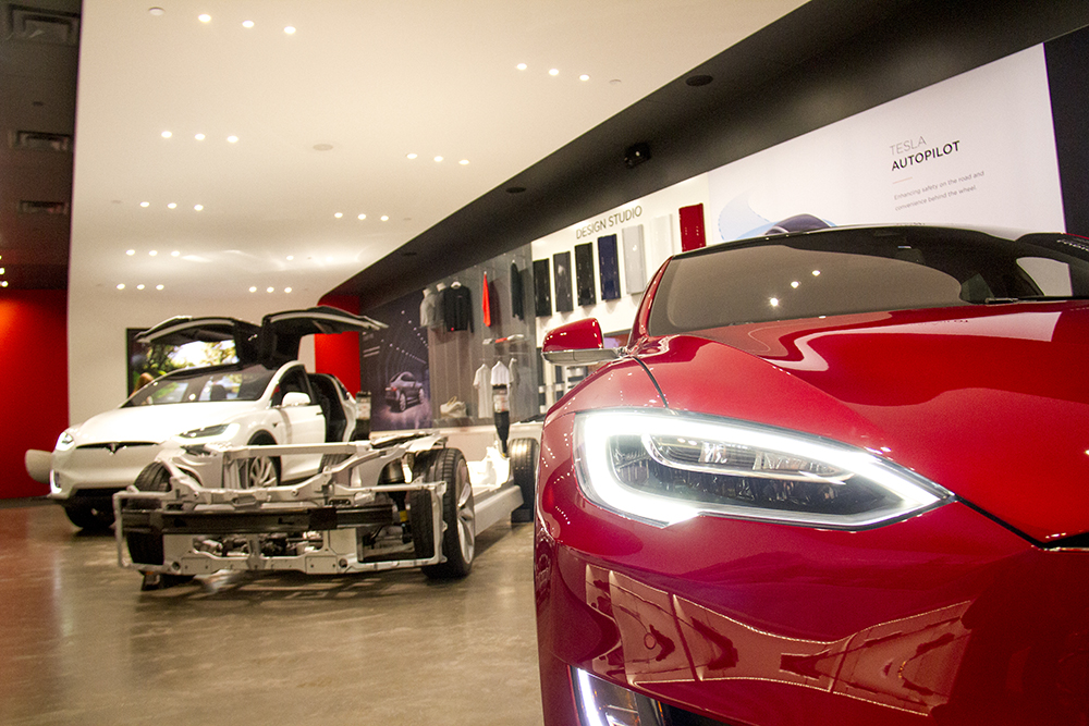 Teslas on the sales floor in the Park Meadows Mall dealership. (Kevin J. Beaty/Denverite)