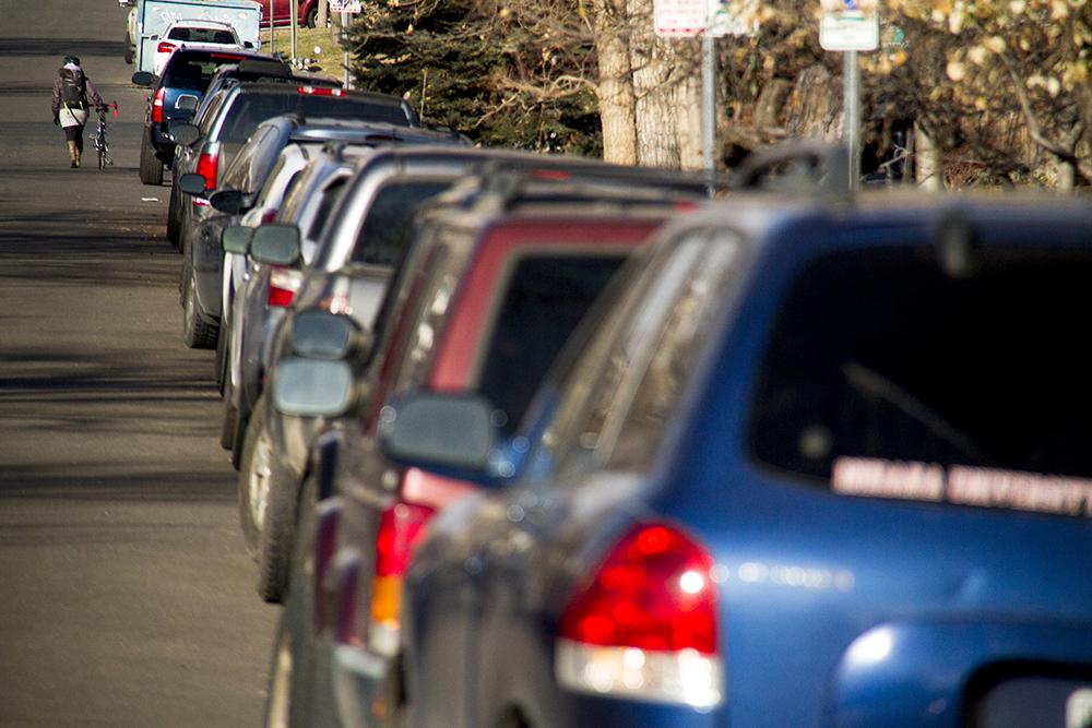 Parallel-parked cars in City Park West. (Kevin J. Beaty/Denverite)  denver; denverite; colorado; cars; kevinjbeaty;