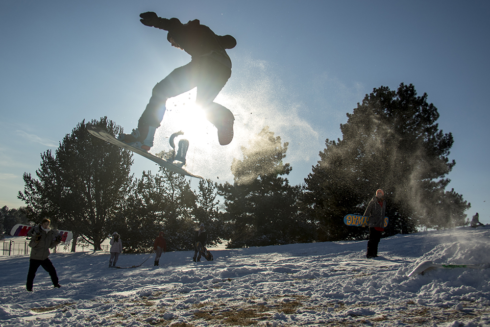 Von Kittelberger flies over a handmade ramp. Dec. 17, 2016. (Kevin J. Beaty/Denverite)  snow day; winter; sledding; denver; denverite; colorado; kevinjbeaty;