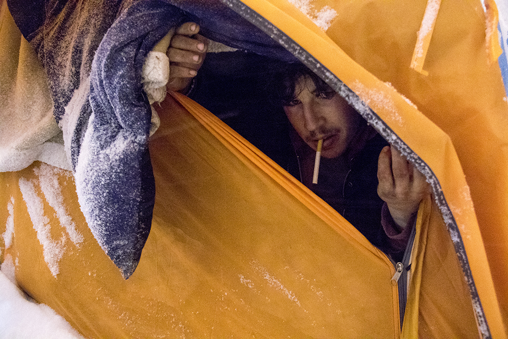 Will in his tent under a blizzard. Dec. 17, 2016. (Kevin J. Beaty/Denverite)  homeless; right to rest; camping ban; blizzard; snow; denver; denverite; kevinjbeaty; colorado; five points;