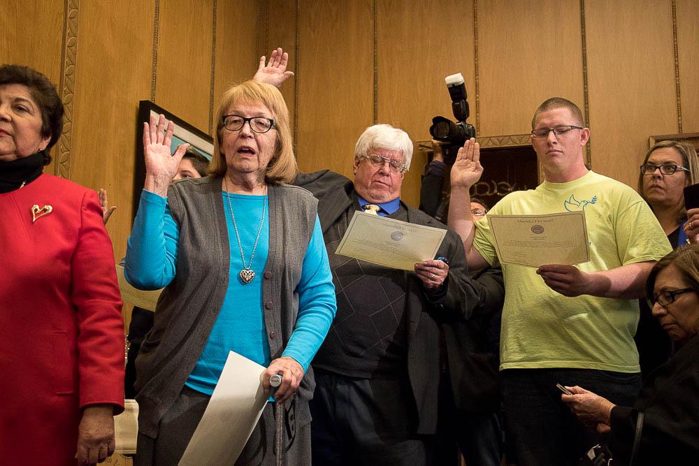 Electors Polly Baca, Anne Hallman, Robert Nemanich and Micheal Baca take their oaths in Governor Hickenlooper's office at the Colorado Capitol. (Chloe Aiello/Denverite)