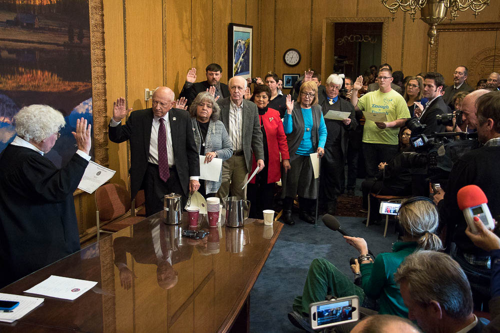 Colorado electors take their oaths in Governor Hickenlooper's office at the Colorado Capitol. (Chloe Aiello/Denverite)
