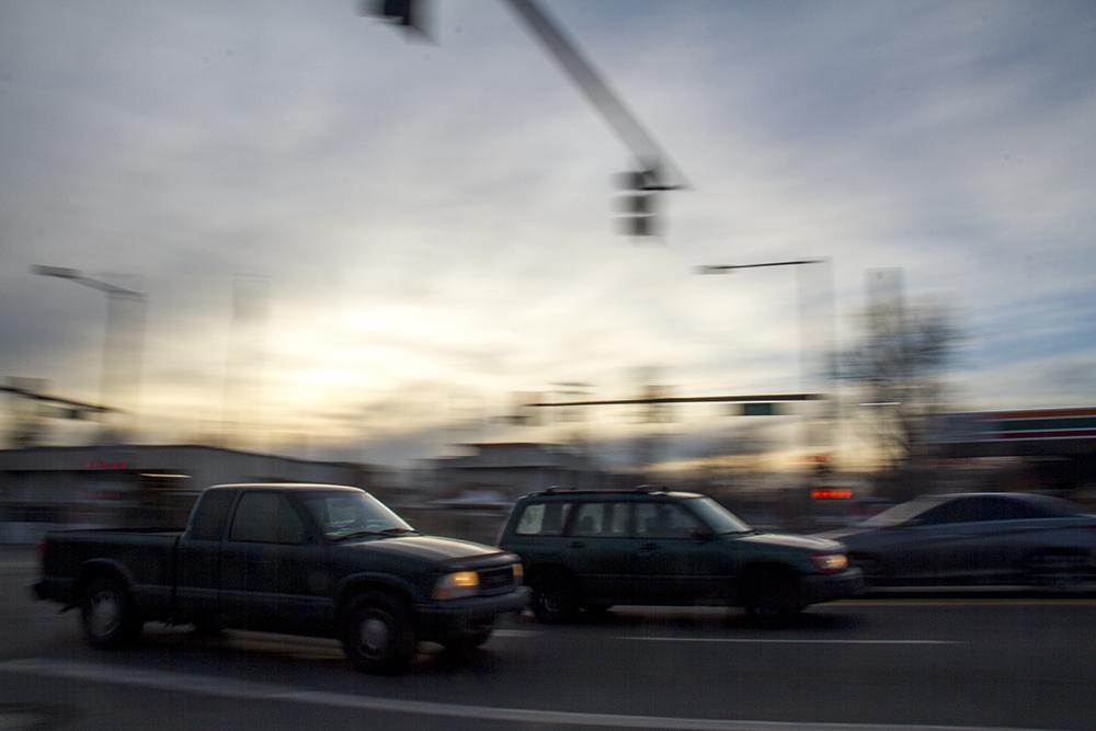 Cars drive down Federal Boulevard. (Kevin J. Beaty/Denverite)  federal boulevard; development; planning; bid; kevinjbeaty; denver; denverite; colorado;