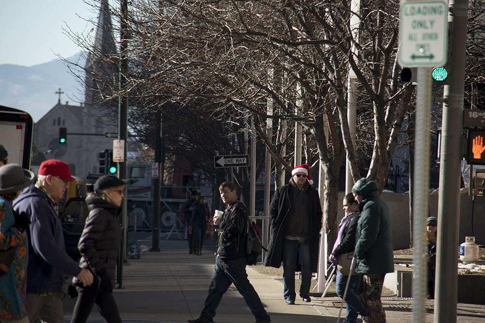 Santa-clad Chris Adams on the 16th Street Mall. Christmas Eve, 2016. (Kevin J.Beaty/Denverite)  cbd; 16th street mall; sixteenth street; christmas eve; holidays; downtown; kevinjbeaty; denver; denverite; colorado;