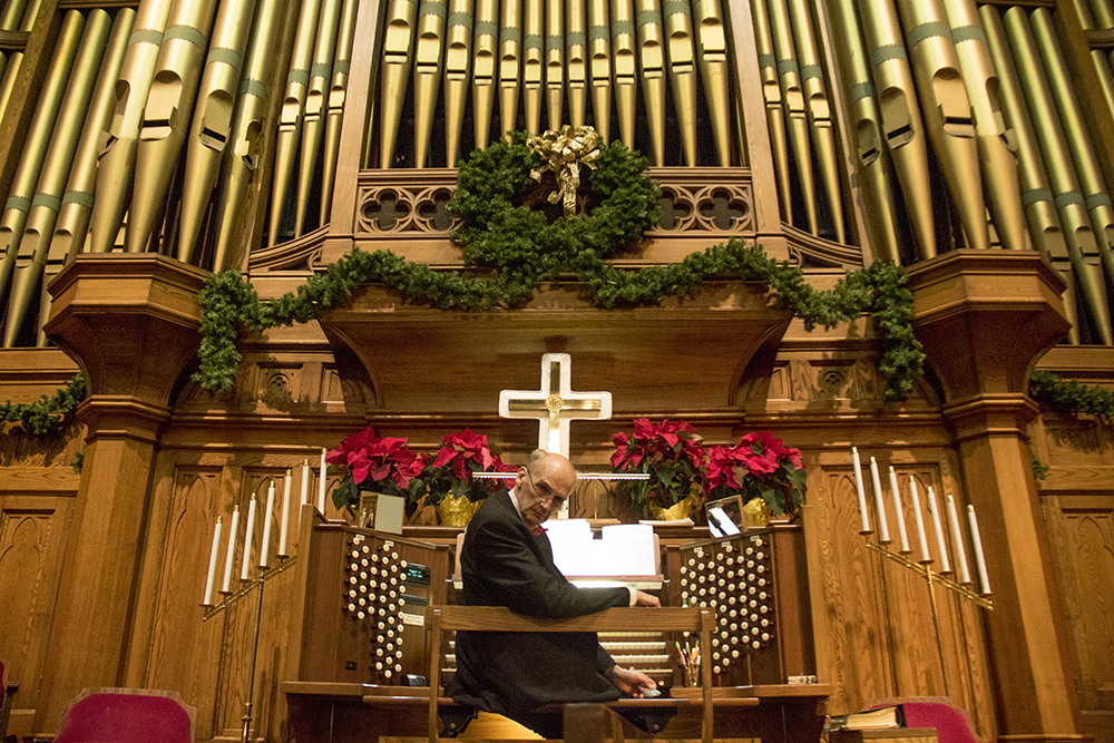 Master Organist Norm Sutphin at the keys. Christmas Eve at Trinity United Methodist Church, 2016, their 152nd anniversary. (Kevin J.Beaty/Denverite)  christmas eve; holidays; downtown; kevinjbeaty; denver; denverite; colorado;
