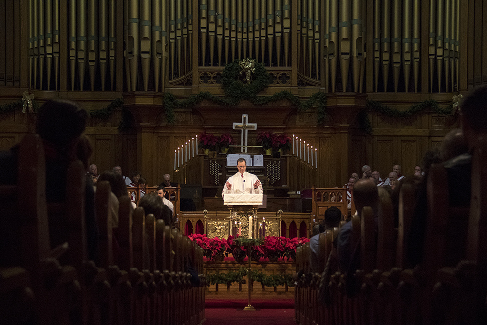 Senior pastor Mike Dent leads the 7 P.M. service. Christmas Eve at Trinity United Methodist Church, 2016. (Kevin J.Beaty/Denverite)  christmas eve; holidays; downtown; kevinjbeaty; denver; denverite; colorado;