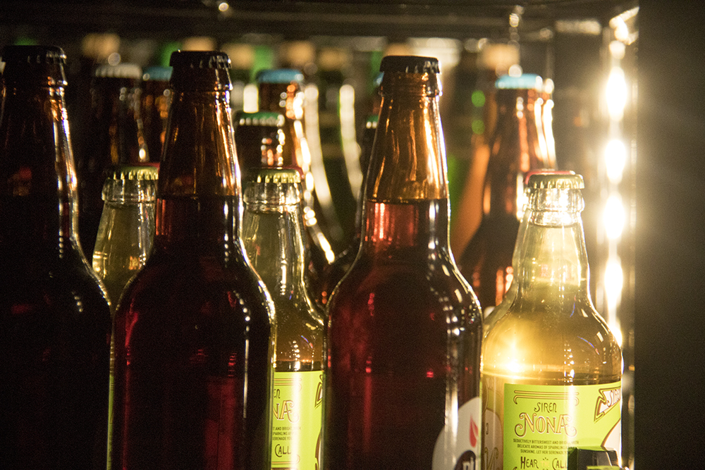 Beer, seen here from inside the cooler at Argonaut Wine & Liquor, Colfax and Clarkson. (Kevin J. Beaty/Denverite)