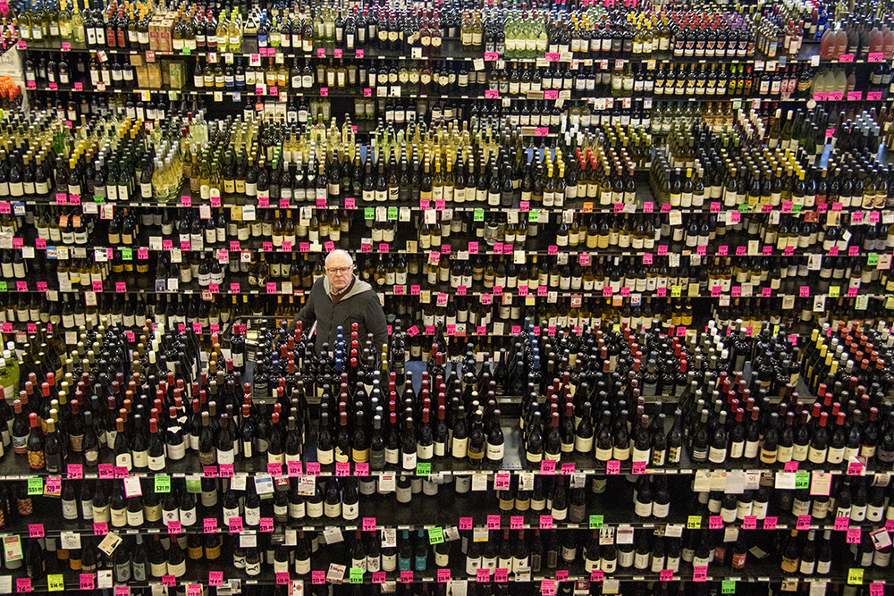 Jim Vetting paruses all of the wine. Argonaut Wine & Liquor, Colfax and Clarkson. (Kevin J. Beaty/Denverite)  beer; wine; liquor store; argonaut; capitol hill; denver; denverite; colorado; kevinjbeaty;