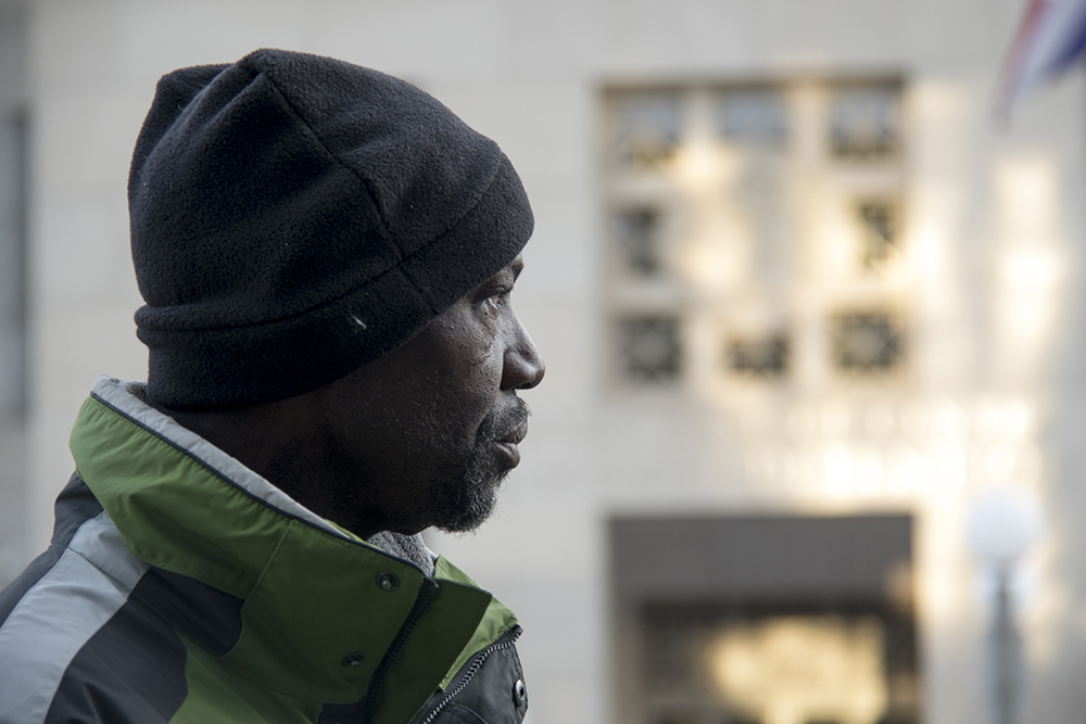 Jerry Burton stands outside the Lindsey Flanigan Courthouse. Dec. 28, 2016. (Kevin J. Beaty/Denverite)  jerry burton; lindsey flanigan courthouse; civic center; right to rest; homeless; kevinjbeaty; denver; denverite; colorado;