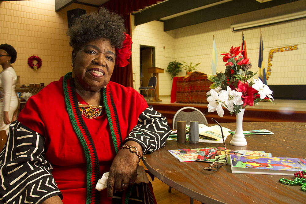 Dr. Claudette Sweet, program committee chair for the Kwanzaa Committee of Denver. The 2016 Kwanzaa Elders Luncheon at Zion Senior Center in Northeast Park Hill. Dec. 28, 2016. (Kevin J. Beaty/Denverite)  kwanzaa; culture; kevinjbeaty; denver; denverite; northeast park hill; colorado;