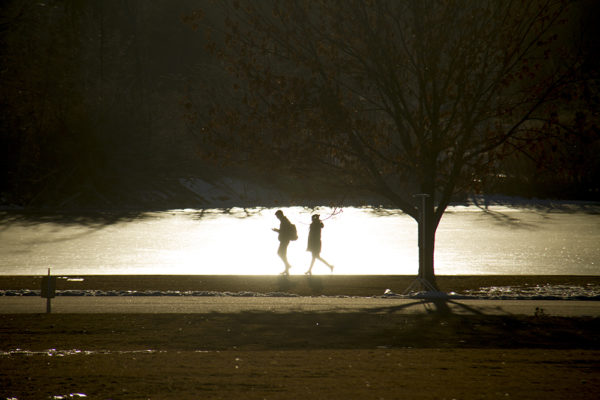 A couple walk by the frozen Ferril Lake in City Park. (Kevin J. Beaty/Denverite)  city park; denver; denverite; colorado; winter; kevinjbeaty;
