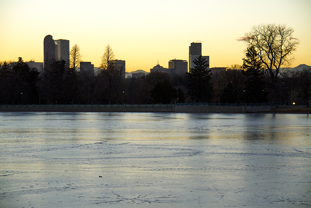 Denver over the frozen Ferril Lake in City Park. (Kevin J. Beaty/Denverite)  skyline; cityscape; city park; denver; denverite; colorado; winter; kevinjbeaty;