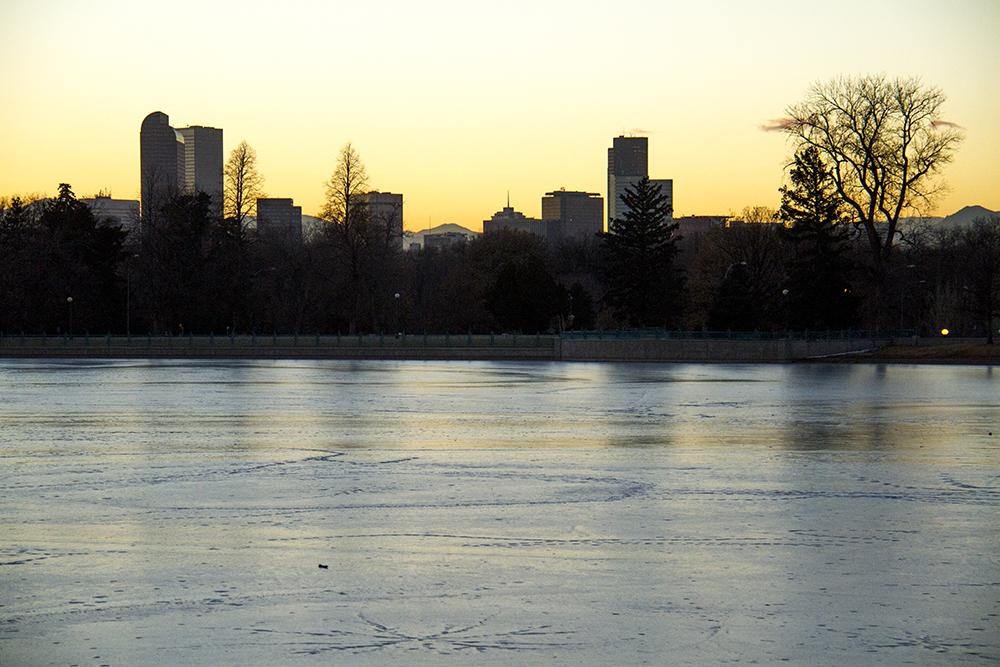 Denver over the frozen Ferril Lake in City Park. (Kevin J. Beaty/Denverite)  skyline; cityscape; city park; denver; denverite; colorado; winter; kevinjbeaty;