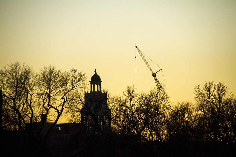 East High school and a crane. (Kevin J. Beaty/Denverite)