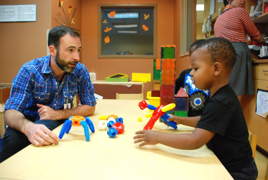 A staff member works with preschoolers at Educare Denver at Clayton Early Learning. (Chalkbeat)