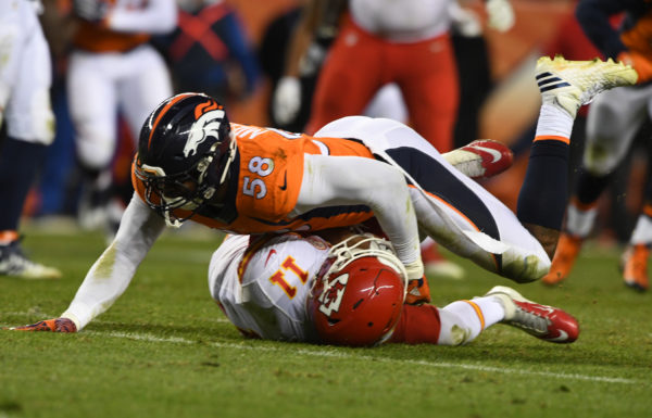 Denver Broncos linebacker Von Miller (58) sacks Kansas City Chiefs wide receiver Demarcus Robinson (11) in the second half  of the NFL game at  Sports Authority Field in Denver, Colo. November 27, 2016.(Photo: © Eric Lars Bakke/ Denver Broncos)
