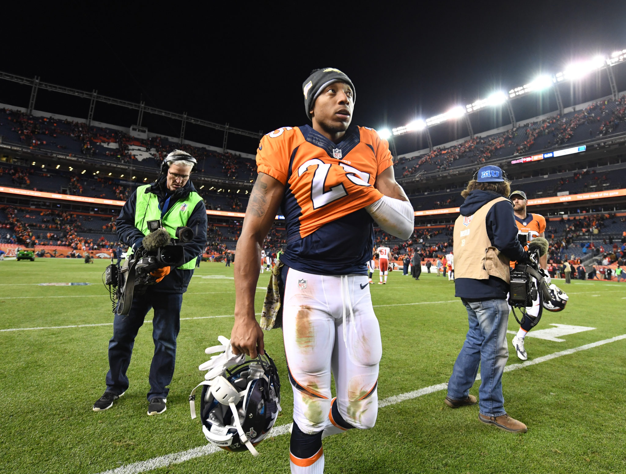 Denver Broncos cornerback Chris Harris Jr. (25) walks off the field dejected after Denver loses to  the Kansas City Chiefs 30-27 in overtime in the NFL game at  Sports Authority Field in Denver, Colo. November 27, 2016.