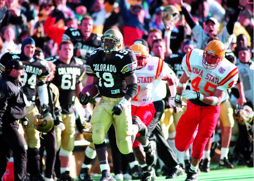 Rashaan Salaam goes over the 2,000-yard mark against Iowa State. (Rocky Mountain News Photograph Collection/Denver Public Library/RMN-048-9135)