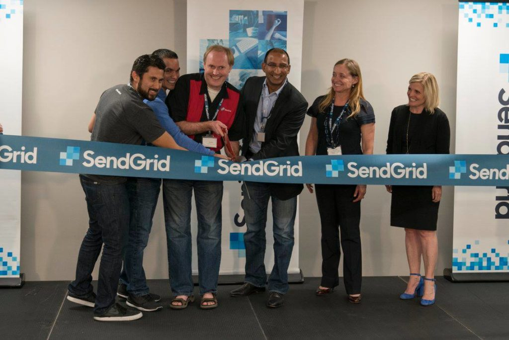 SendGrid's executive team and founders cut the ribbon on their new, Denver office. (Courtesy of SendGrid)