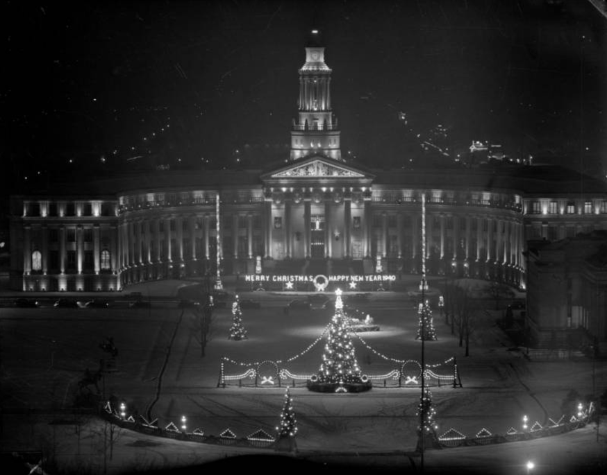 "The Denver City and County Building is decorated for Christmas, Denver, Colorado. Sign reads: ""Merry Christmas Happy New Year 1940.""  (Denver Public Library/Western History Collection/Rh-4554)"