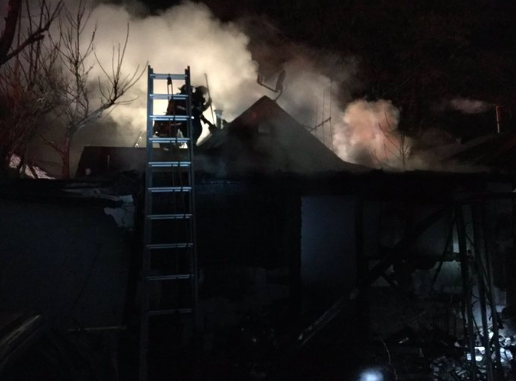 Firefighters battle a house fire at 4728 Vine St. in Elyria Swansea. (Courtesy Denver Fire)