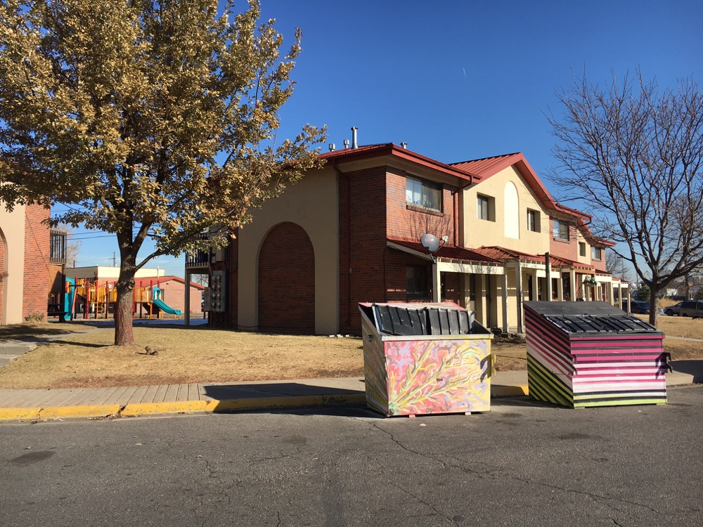 Painted Dumpsters in Sun Valley, part of a Birdseed Collective projected funded by a P.S. You Are Here Grant in 2016. (Kevin J. Beaty/Denverite)