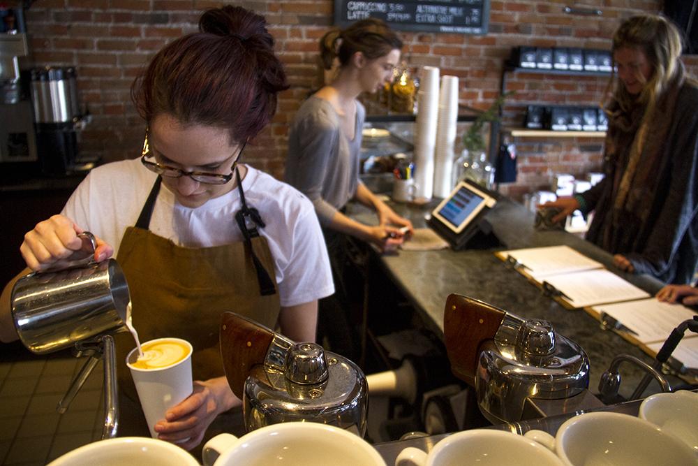 Barista Cecelia Meserve makes a latte at Thump Coffee on 13th Avenue. (Kevin J. Beaty/Denverite)  coffee shop; capitol hill; food; denver; denverite; colorado; kevinjbeaty;