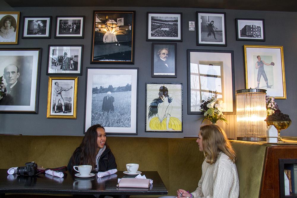 Mara Petre and Darcy Neureiter sit inside Black Eye Coffee on Sherman Street. (Kevin J. Beaty/Denverite)  coffee shop; capitol hill; food; denver; denverite; colorado; kevinjbeaty;