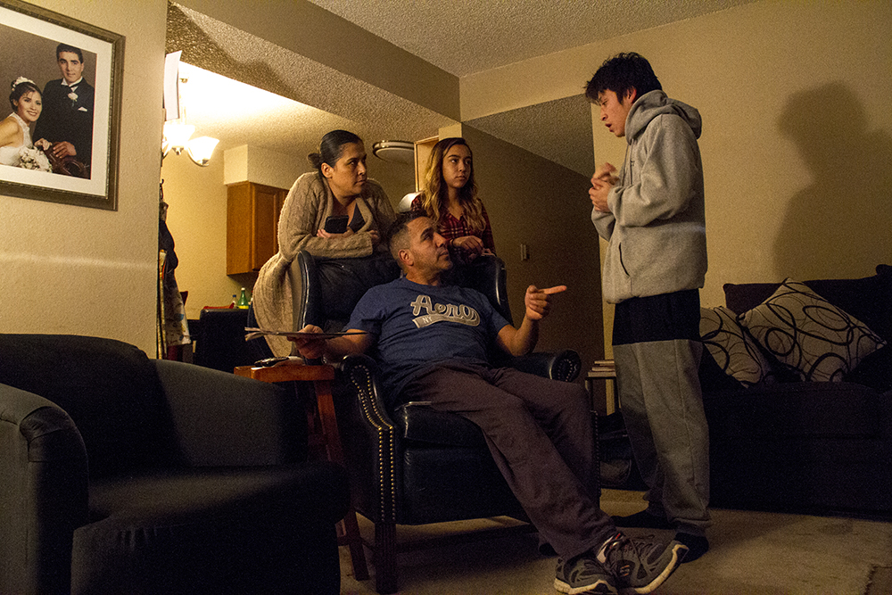 Isidro Quintana with his wife, Erica, and daughter, Ana Victoria, warning his son, Carolos, not to be out too late. Jan. 4, 2017. (Kevin J. Beaty/Denverite)  isidro quintana; kevinjbeaty; denverite; denver; colorado; immigration; deportation;