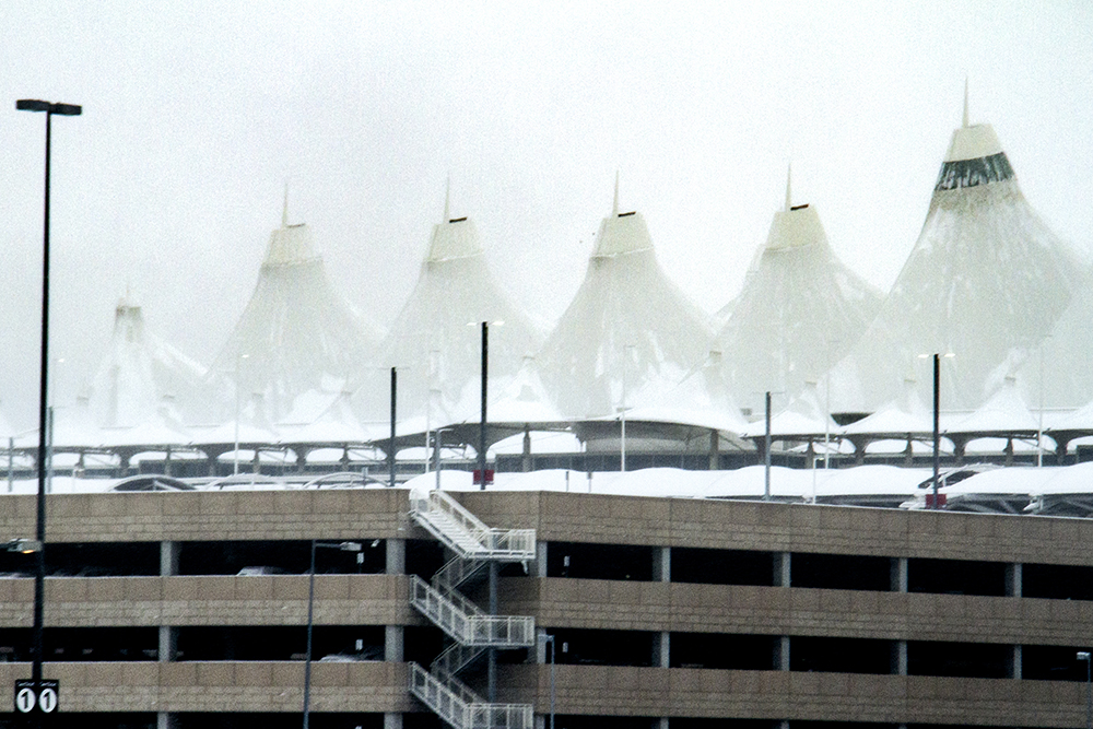 DIA on a freezing morning, seen driving up to the terminal. Jan. 5, 2016. (Kevin J. Beaty/Denverite)  dia; airport; snow; weather; cowx; denverite; denver; colorado; kevinjbeaty;
