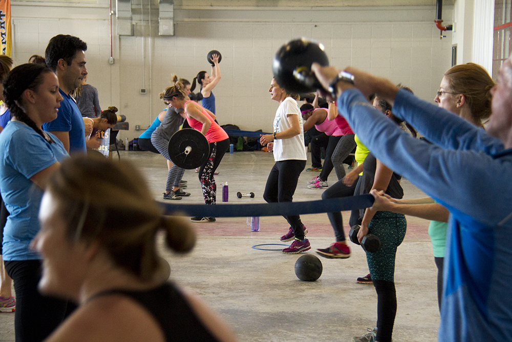 "Endorphin ""boot camp"" in the hanger at Stanley Marketplace. Jan 7, 2016. (Kevin J. Beaty/Denverite)  stanley marketplace; aurora; retail; kevinjbeaty; colorado; denverite; exercise; workout; gym;"