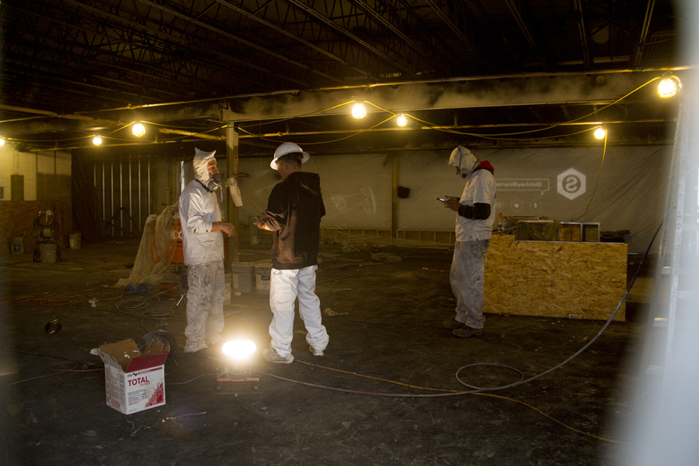 Painters at work inside Stanley Marketplace. Jan 7, 2016. (Kevin J. Beaty/Denverite)  stanley marketplace; aurora; retail; kevinjbeaty; colorado; denverite;