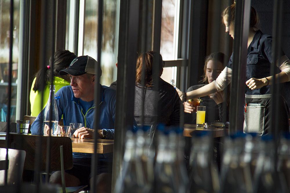 Bryant Palmer sits in the Stanley Beer Garden. Stanley Marketplace. Jan 7, 2016. (Kevin J. Beaty/Denverite)  stanley marketplace; aurora; retail; kevinjbeaty; colorado; denverite;