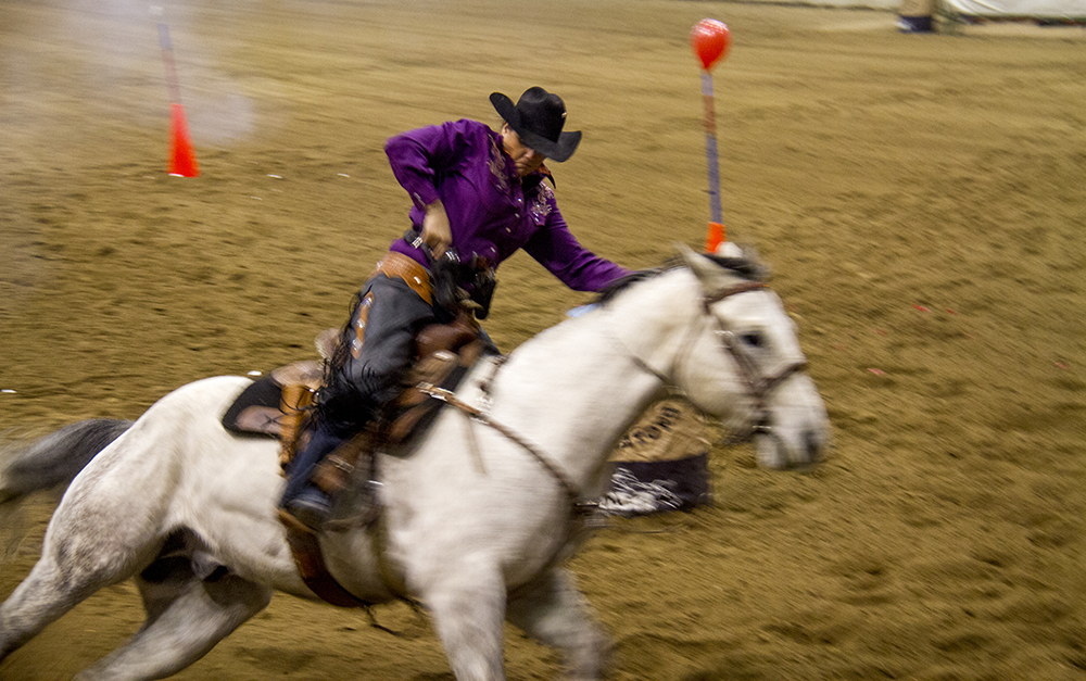 Schandra Pfeiff. CMSA Cowboy Mounted Shooting competition. National Western Stock Show. Jan. 8, 2016. (Kevin J. Beaty/Denverite)  national western stock show; nwss; national western center; cowboy; kevinjbeaty; denver; denverite; colorado;