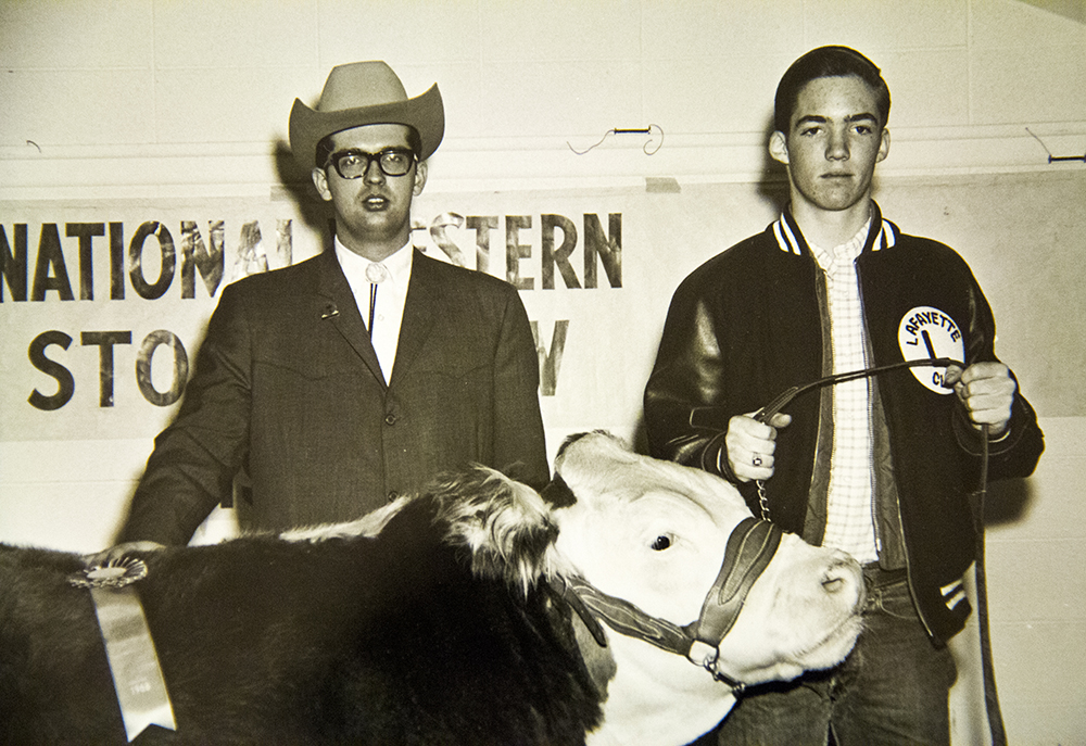 "Charles Waneka wins a ribbon in the ""catch-it-calf"" competition at the 1967 National Western Stock Show. (Denver Public Library/Western History Collection/Denver Metro Chamber of Commerce Records)  denver; denverite; denver public library; western history collection; archive; archival; National Western Stock Show; nwss;"