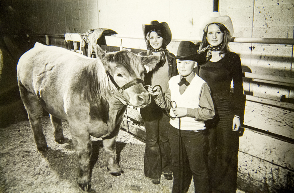 A family and a cow at the National Western Stock Show, date unknown. (Denver Public Library/Western History Collection/Denver Metro Chamber of Commerce Records)  denver; denverite; denver public library; western history collection; archive; archival; National Western Stock Show; nwss;