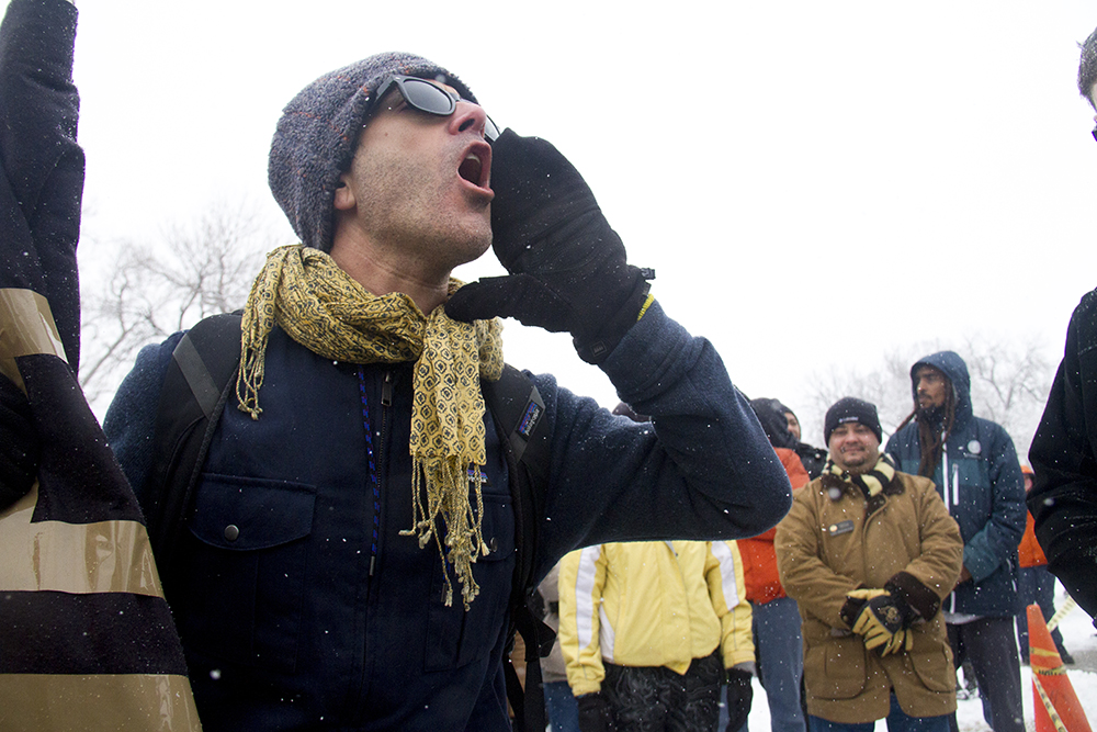 Frank Anello yells against the Affordable Care Act's repeal as U.S. Representative Mike Coffman speaks. The Martin Luther King Jr. Marade, Jan. 16, 2017. (Kevin J. Beaty/Denverite)  mlk; marade; martin luther king jr; city park; denver; colorado; kevinjbeaty;