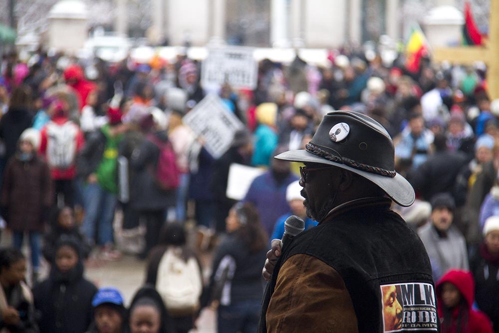 Martin Luther King Jr. Marade Chair Vern Howard speaks as the procession fills Civic Center Park. Jan. 16, 2017. (Kevin J. Beaty/Denverite)  mlk; marade; martin luther king jr; denver; colorado; kevinjbeaty;  civic center park;