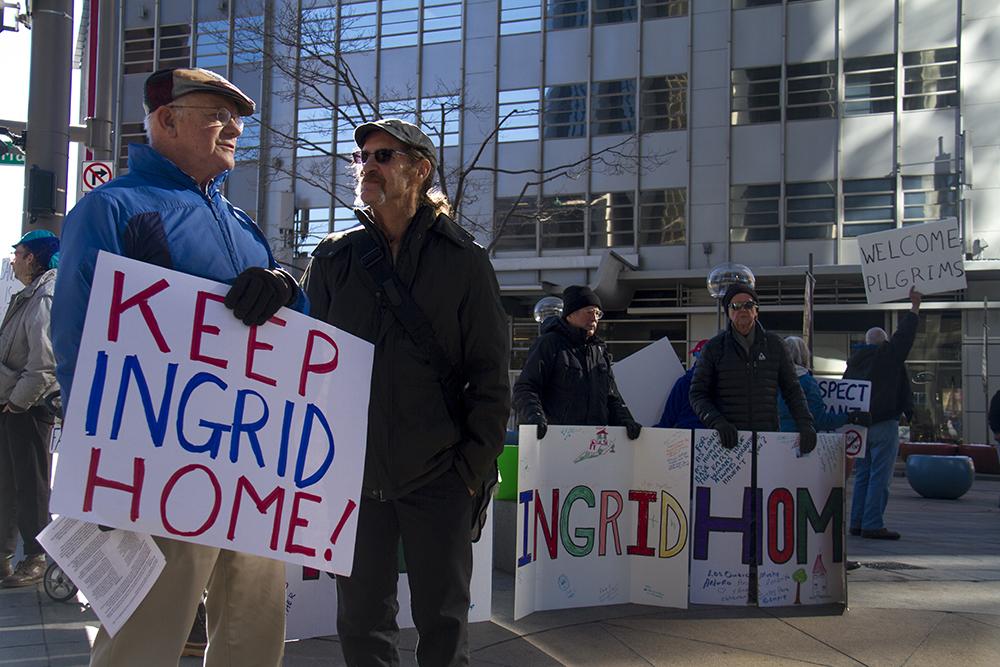 Chris Wheeler and Arnie Carter protest on the 16th Street Mall. Jan. 17, 2017. (Kevin J. Beaty/Denverite)  immigration; 16th street mall; protest; deportation; undocumented; kevinjbeaty; denver; denverite; colorado; ingrid latorre